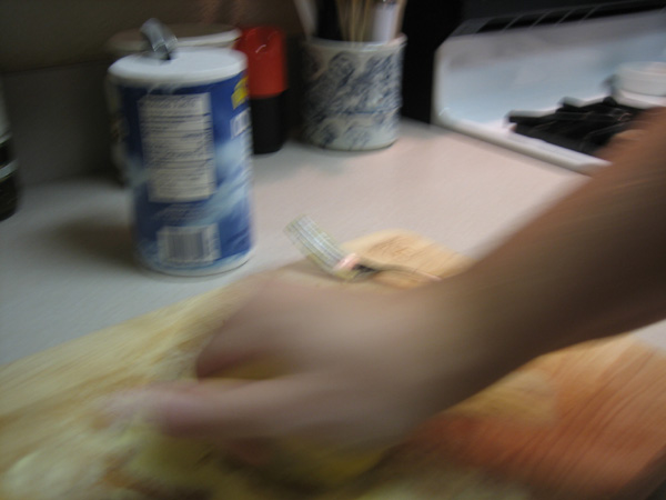 making pasta by hand kneading dough