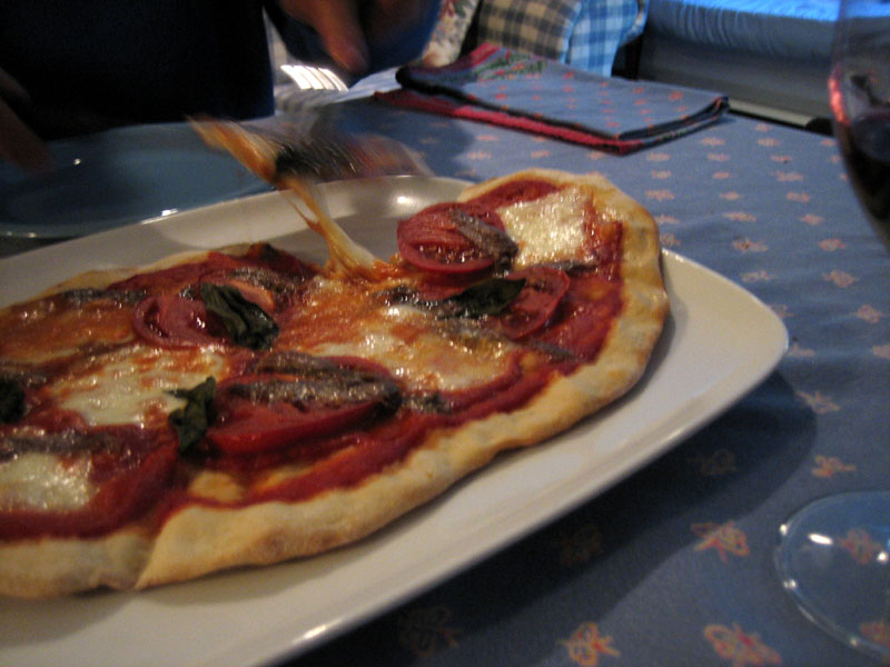 Pizza with Anchovies and Tomatoes