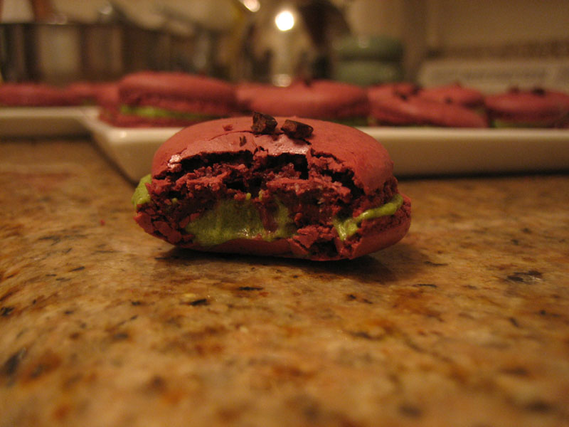 red velvet macarons with matcha buttercream filling (green tea buttercream)