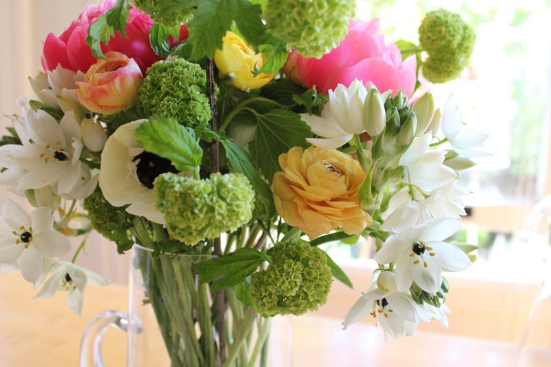 bouquet of white stars, ranunculus, and green pom poms from birite market in san francisco