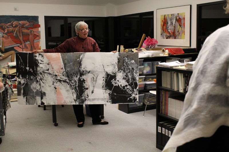 Joanne Ruggles in her studio with her paintings
